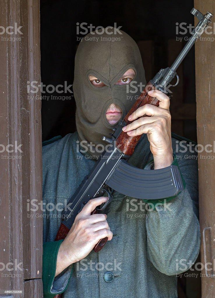 man with a machine gun stock photo