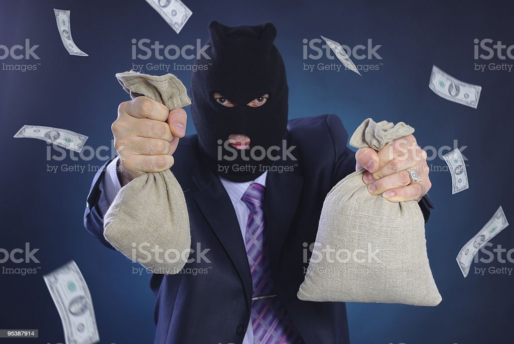 Man with a mask and bags money royalty-free stock photo