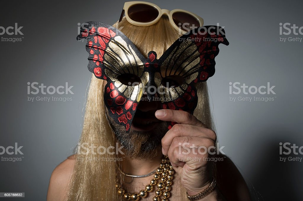 Man with a mask of a butterfly. stock photo