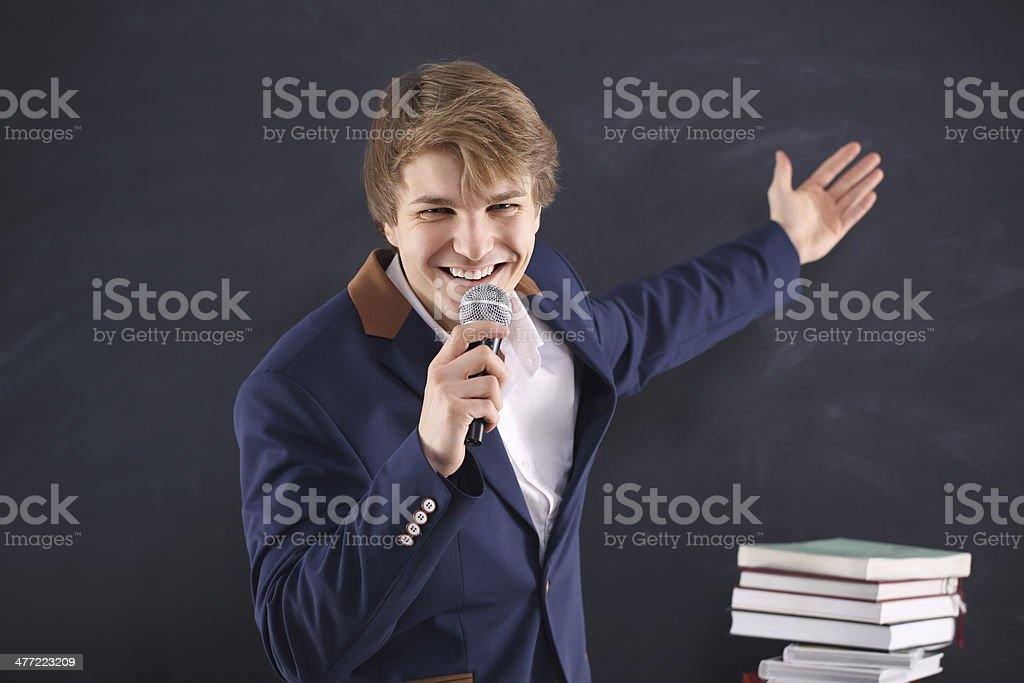 man with a microphone during the presentation of energy royalty-free stock photo