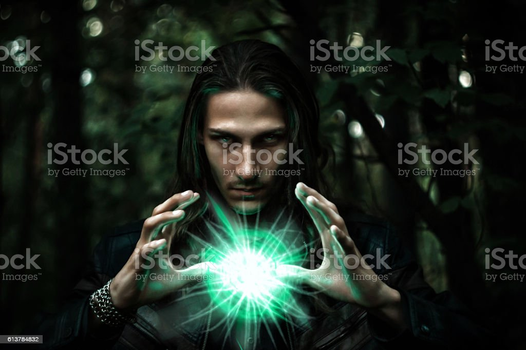 man with a mysterious glowing orb. stock photo