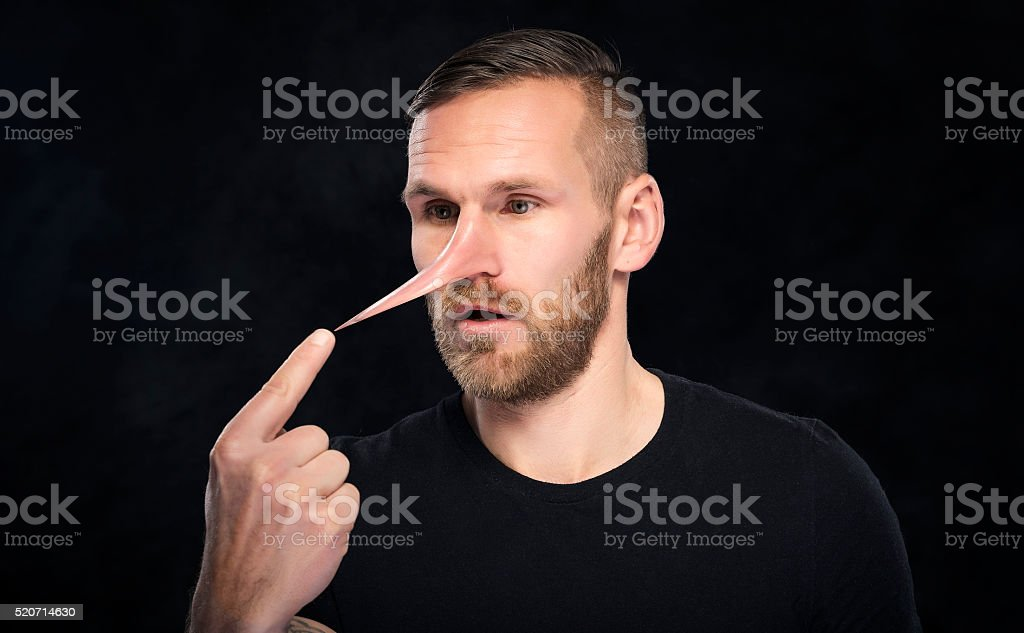 Man with a nose like Pinocchio stock photo