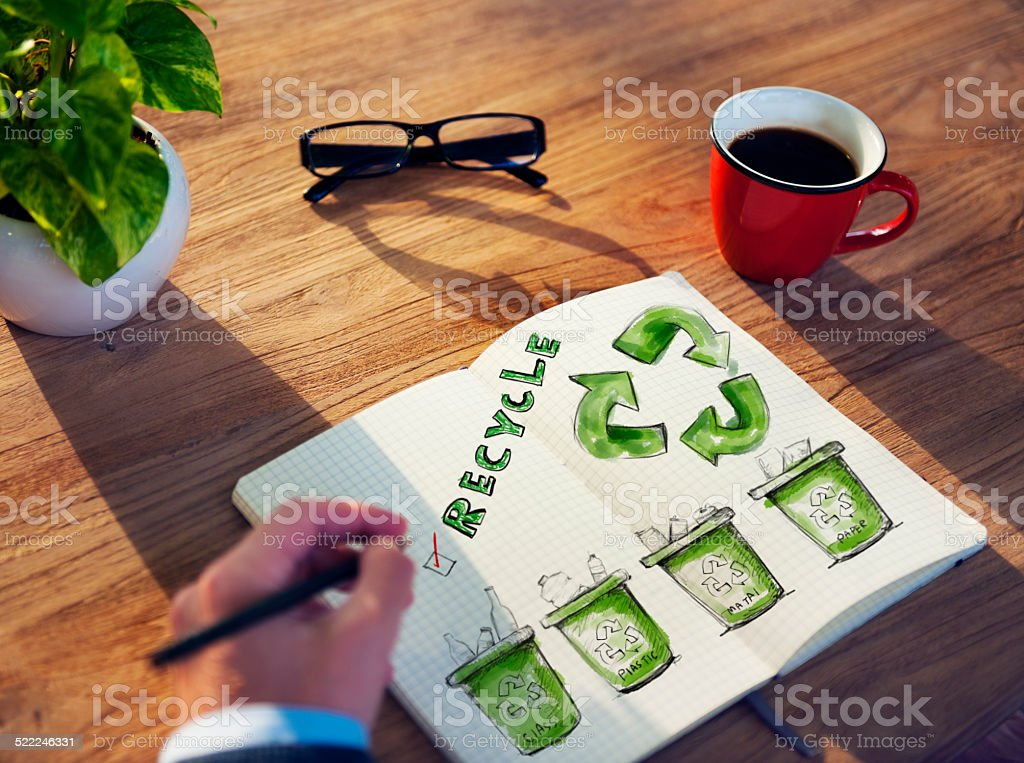 Man with a Notepad with Recycling Concept stock photo