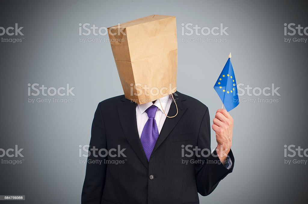Man with a paper bag on the head stock photo