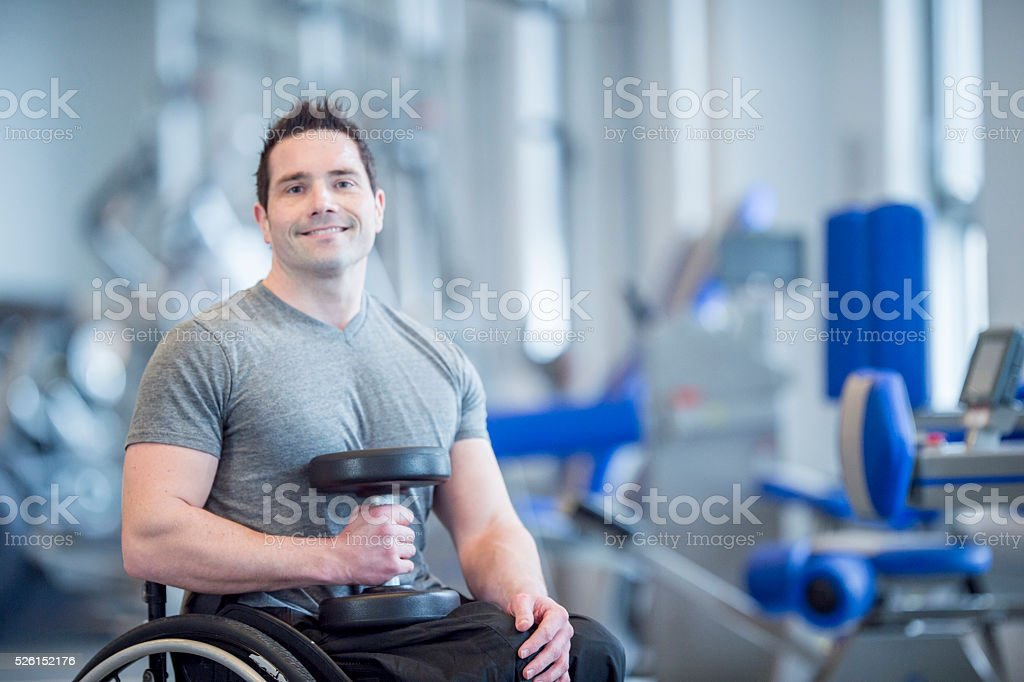 Man with a Physical Disability Lifting Weights stock photo