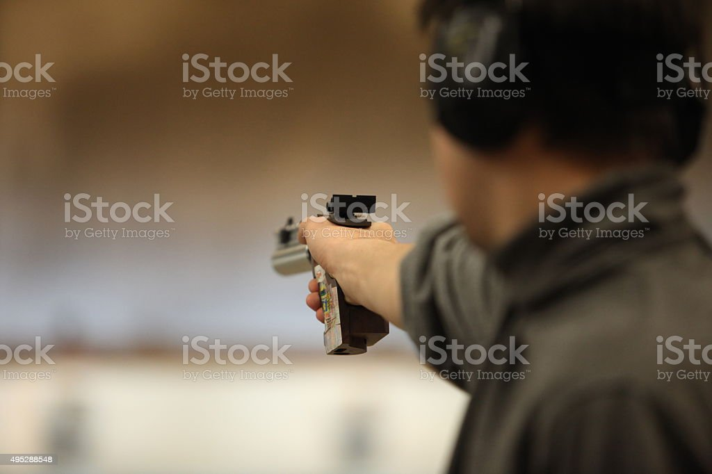 Man with a pistol stock photo