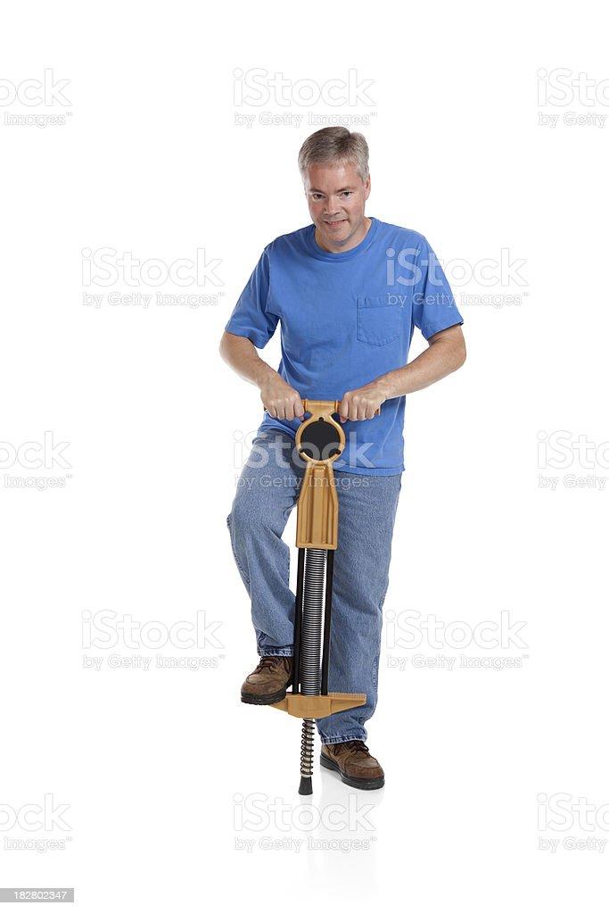 Man with a Pogo Stick stock photo