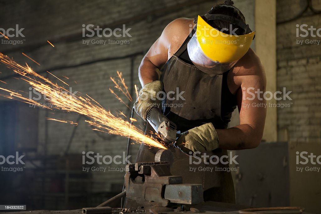 Man  with a power grinder royalty-free stock photo