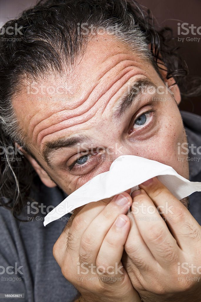 Man with a runny nose royalty-free stock photo