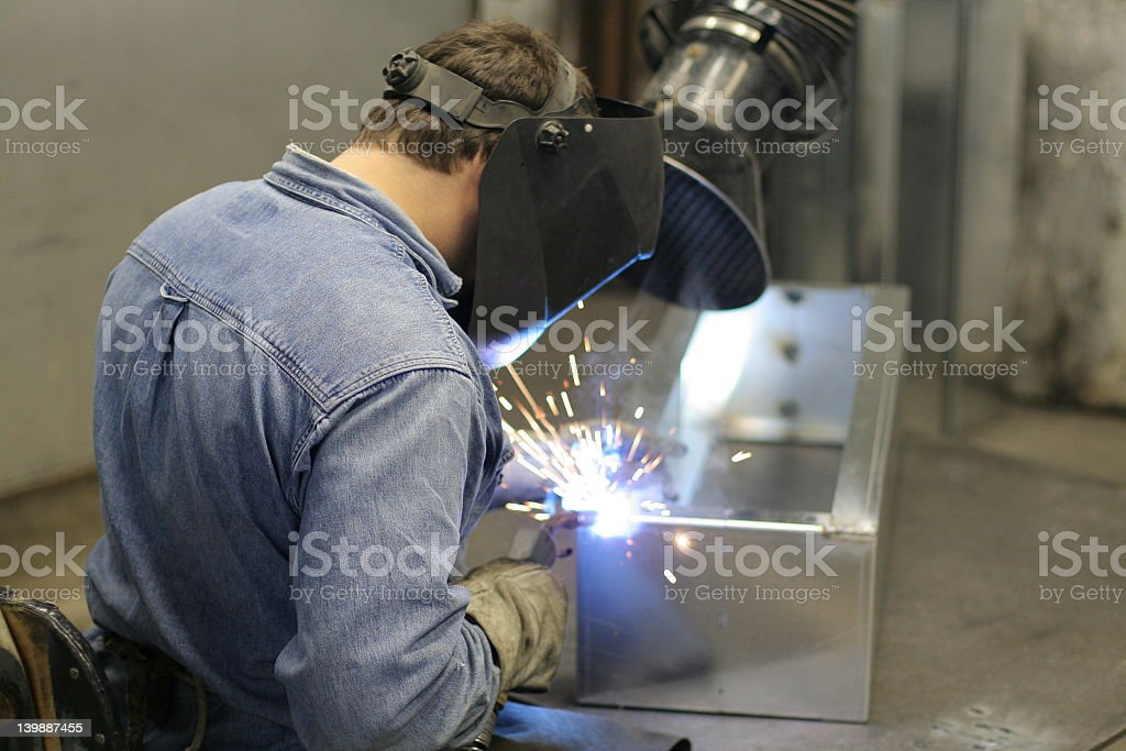 Man with a safety helmet welding royalty-free stock photo