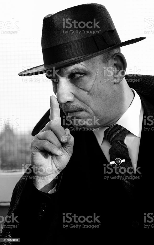 Man with a scar on his cheek stock photo