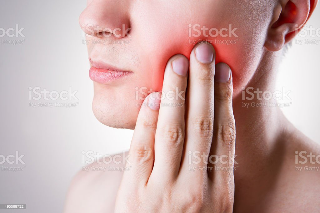 Man with a toothache. Pain in the human body stock photo