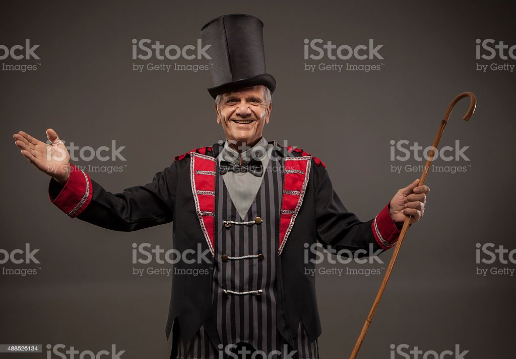 Man with a top hat and a cane. stock photo