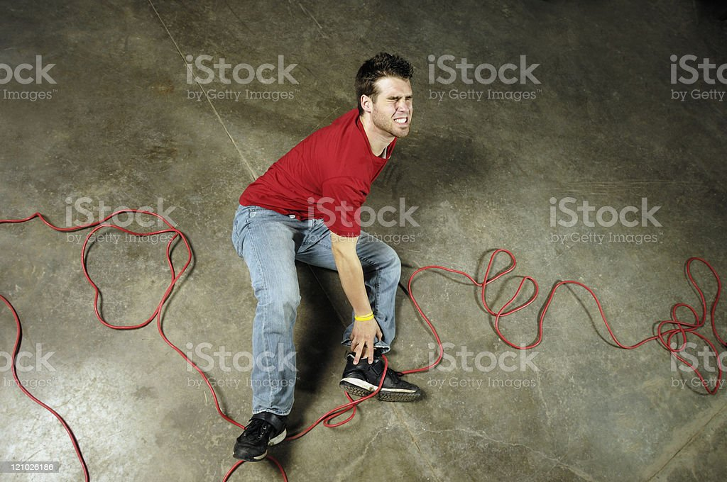 Man with a twisted ankle caused by trip royalty-free stock photo