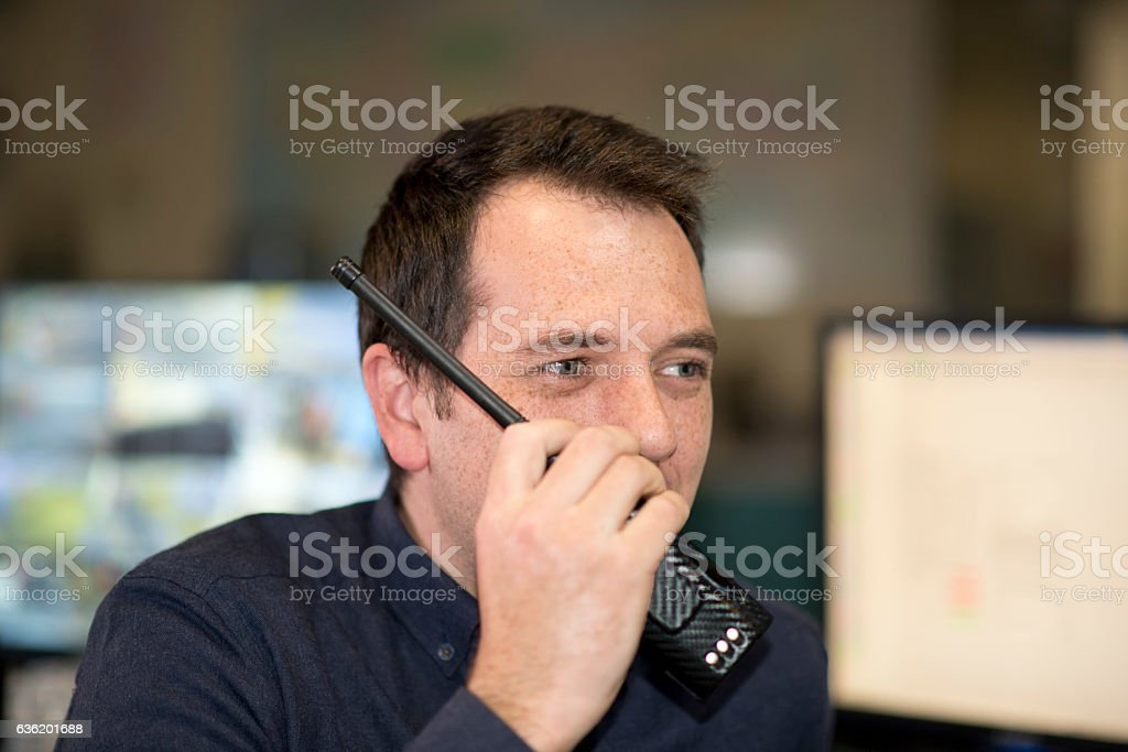 Man with a walkie-talkie stock photo