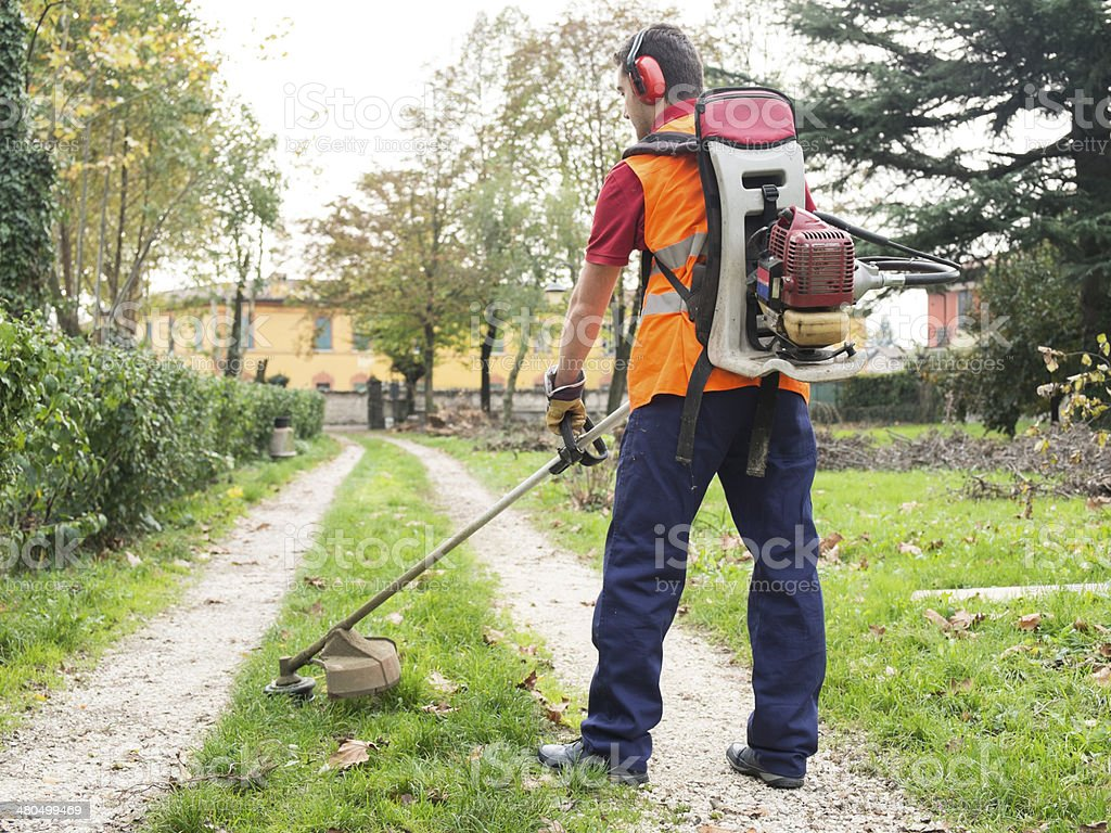 Man with a weed wacker. stock photo