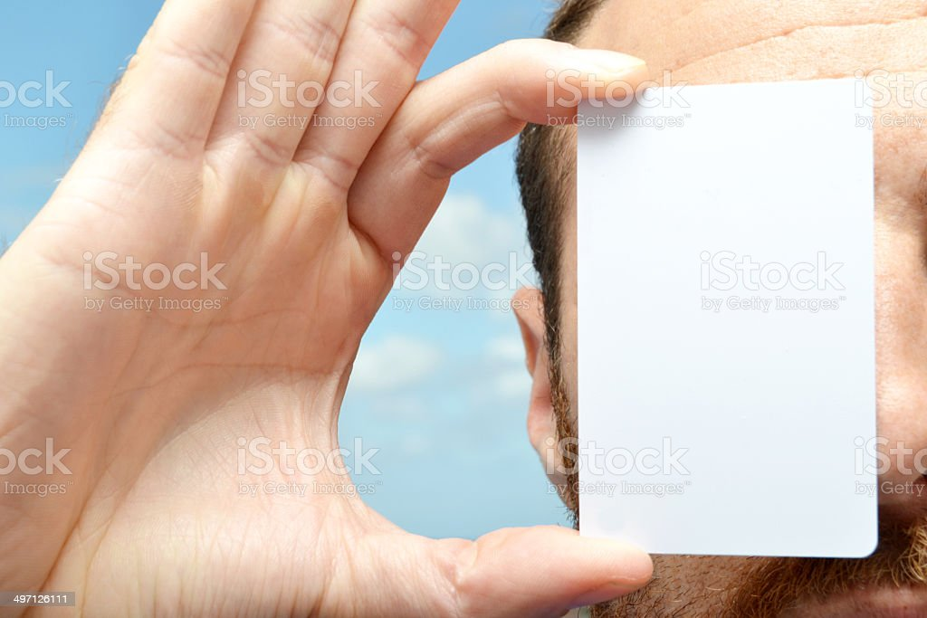 Man with a white card in hand stock photo