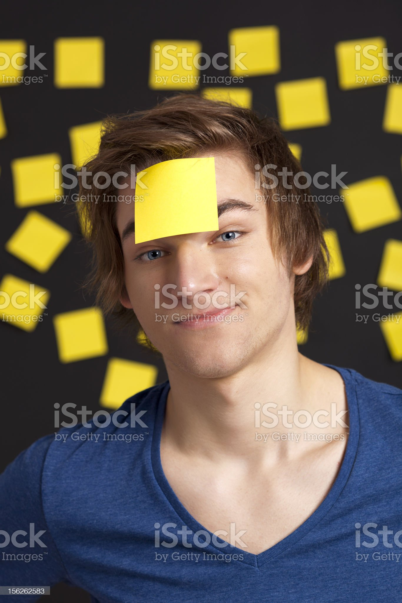 Man with a yellow note in front of head royalty-free stock photo
