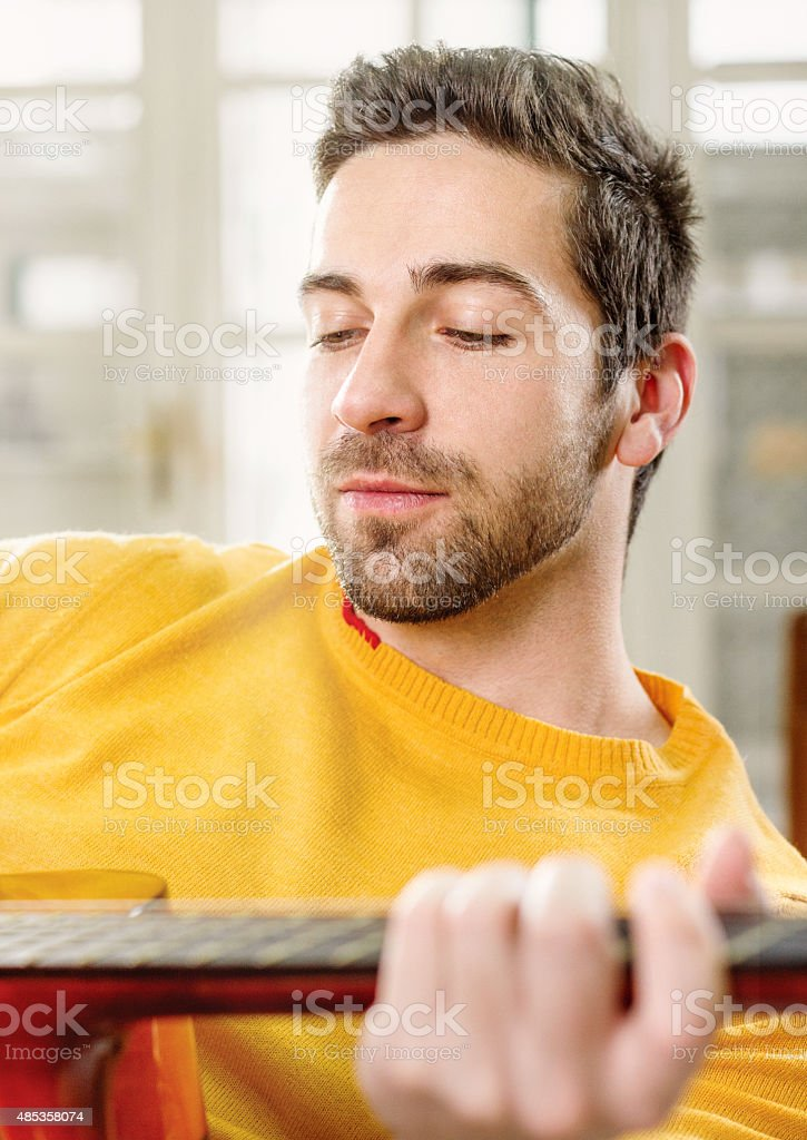 Man with acoustic guitar stock photo