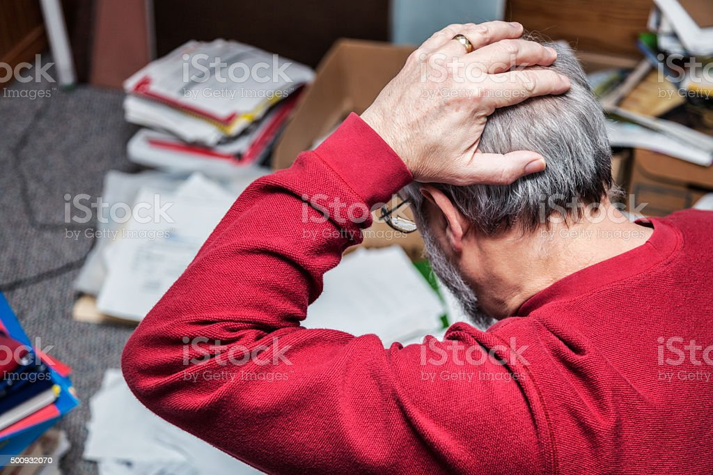 Man With ADD Frustrated By Messy Room stock photo