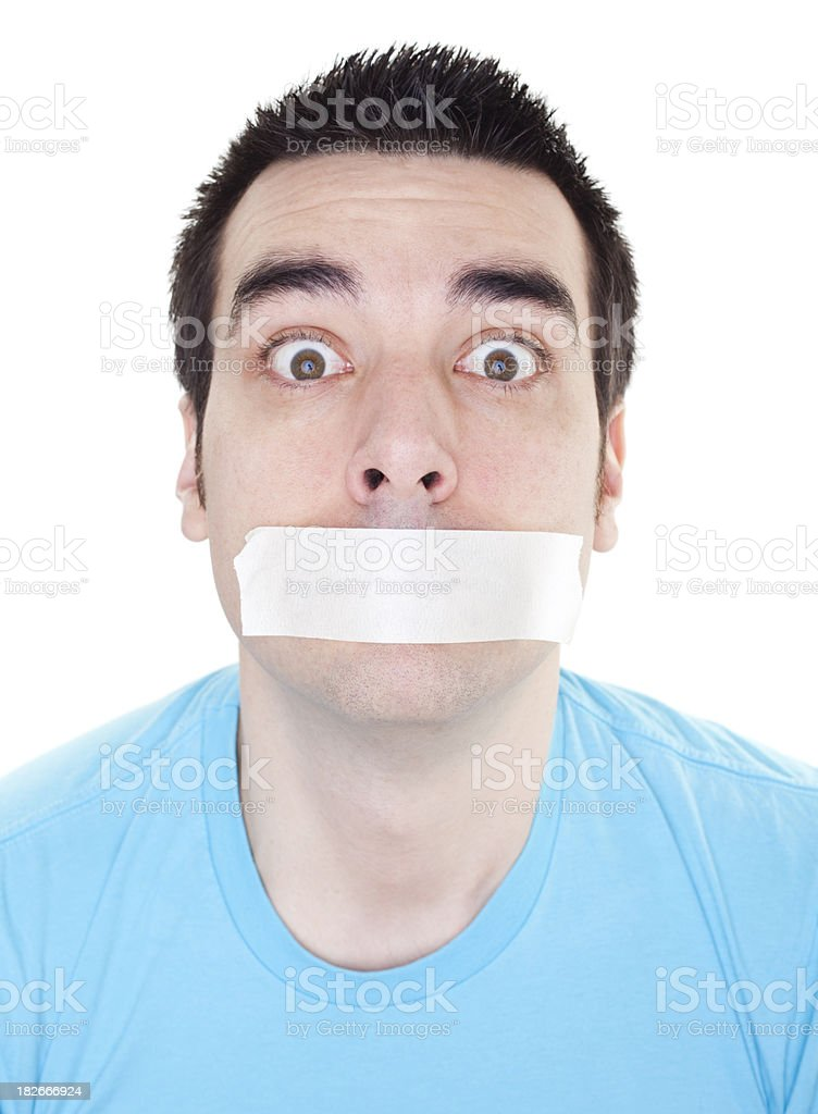 Man with adhesive tape over mouth. stock photo