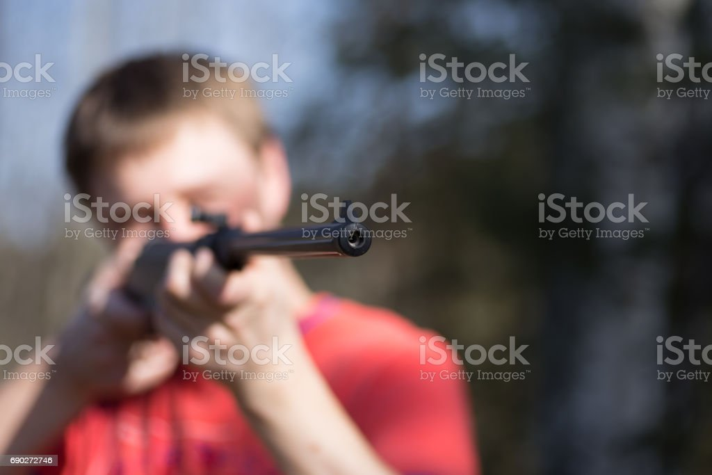 man with air gun stock photo