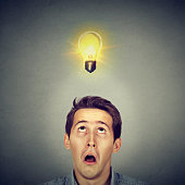 Man with amazed face expression light bulb over head