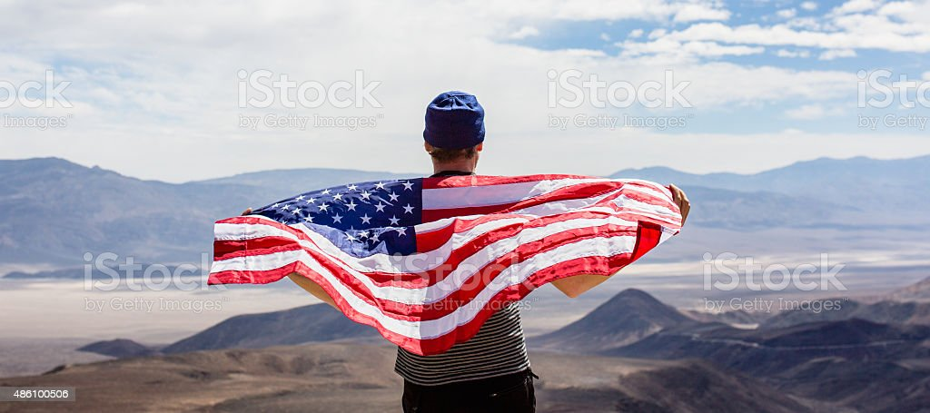 Man with American flag stock photo
