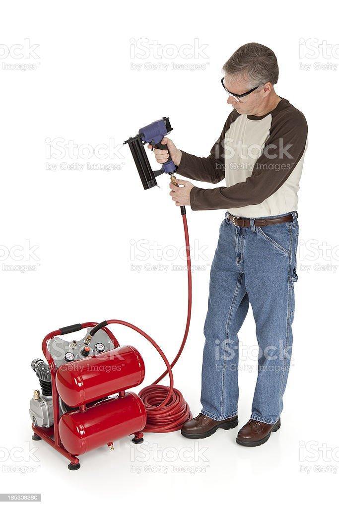 Man with an Air Nail Gun stock photo