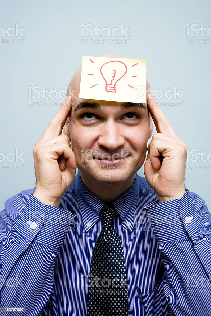 Man with an idea demonstrated with lightbulb picture royalty-free stock photo