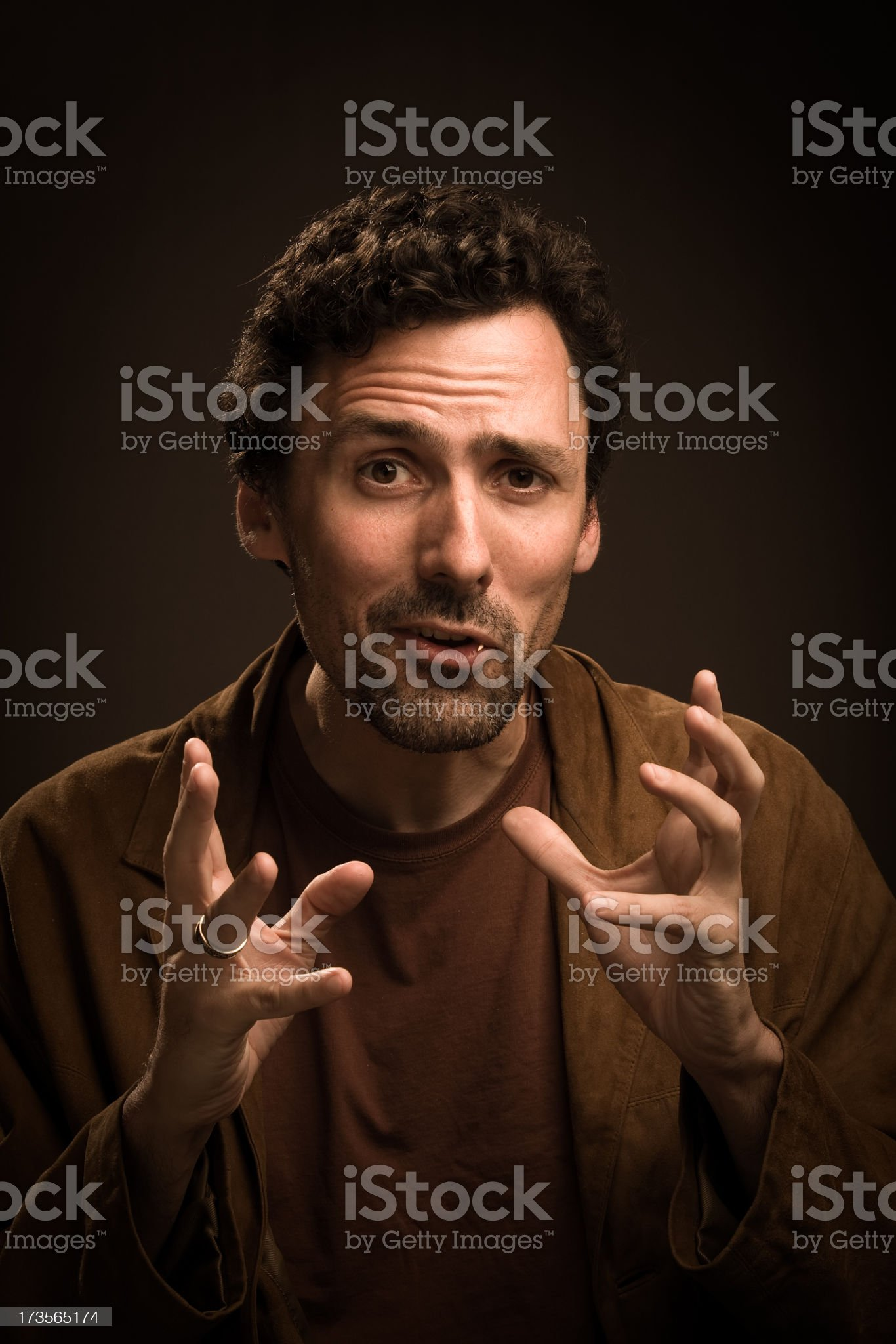 Man with an intense expression and hands raised royalty-free stock photo