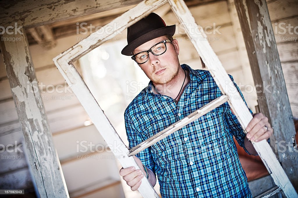 Man with an old window frame royalty-free stock photo