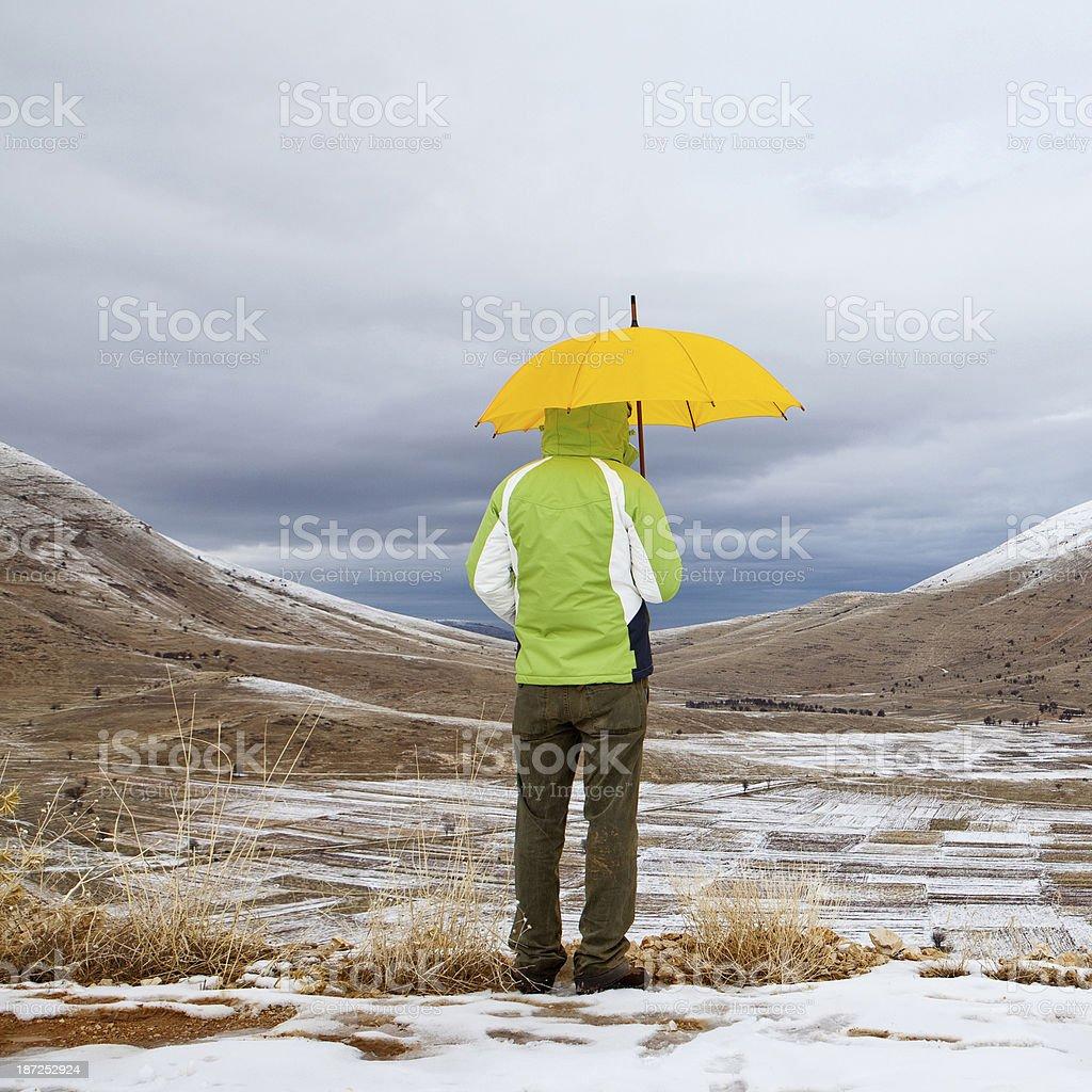 Man with an umbrella royalty-free stock photo