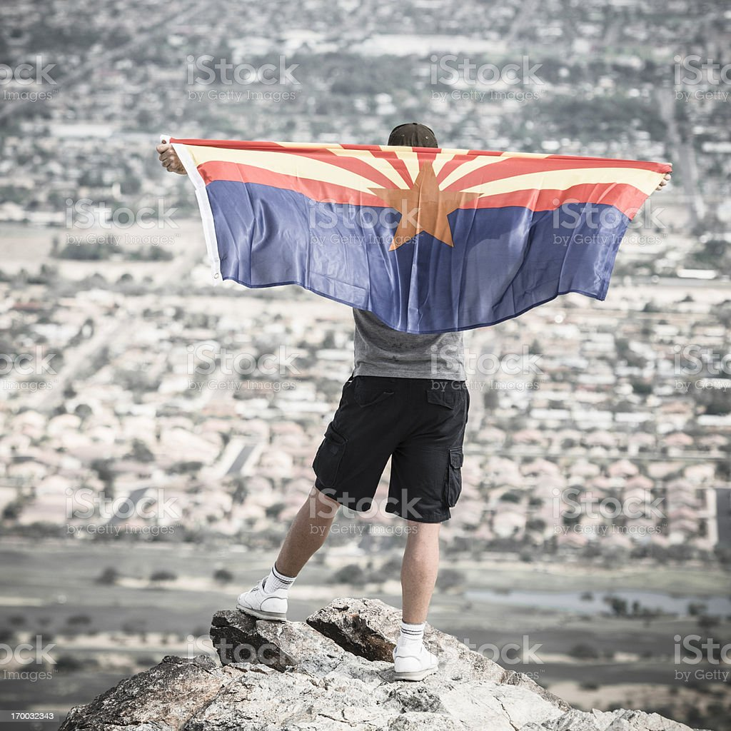 Man with arizona flag against phoenix panorama royalty-free stock photo