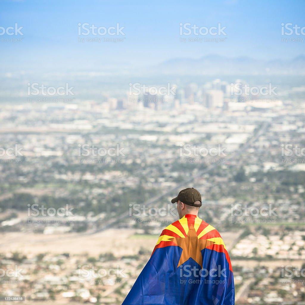 Man with arizona flag against phoenix panorama stock photo