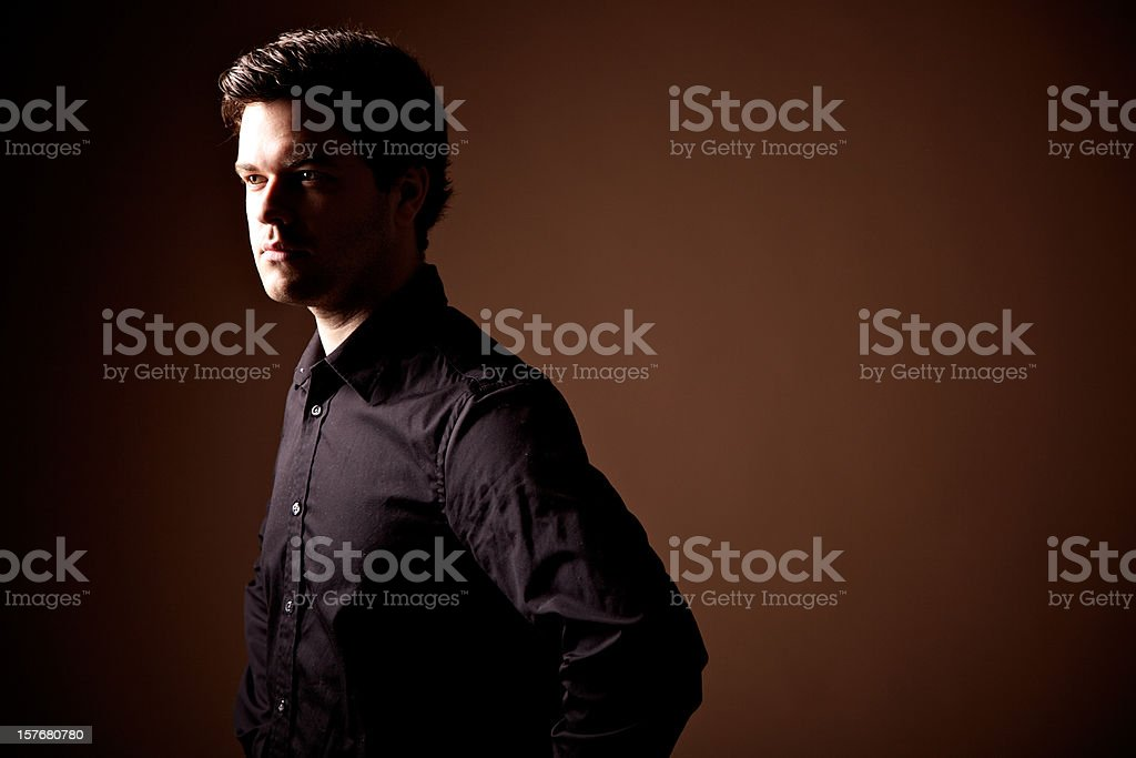 Man with arm crossed looking at the camera stock photo