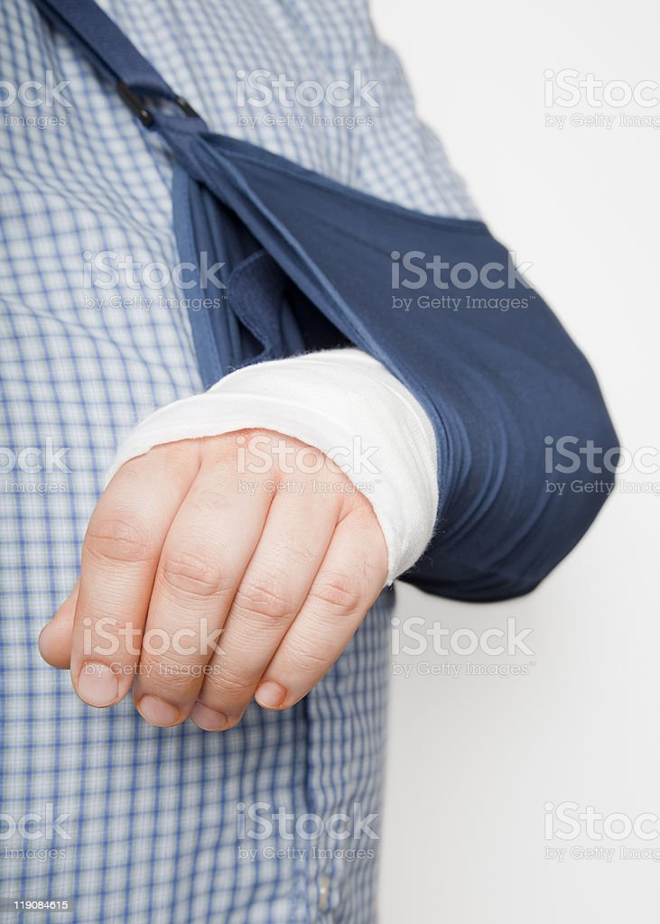 man with arm in sling stock photo