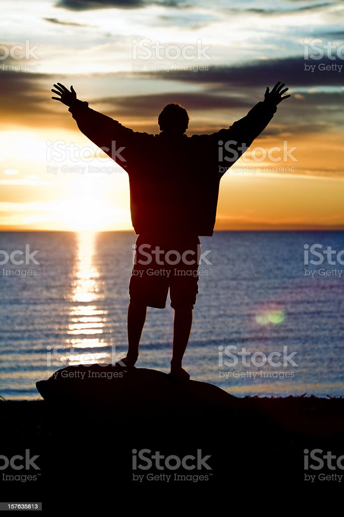 man with arms up royalty-free stock photo