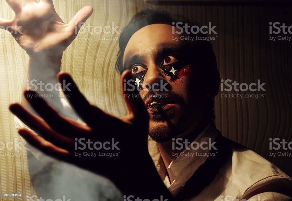 Man with art hallowen party grimm in magic. stock photo