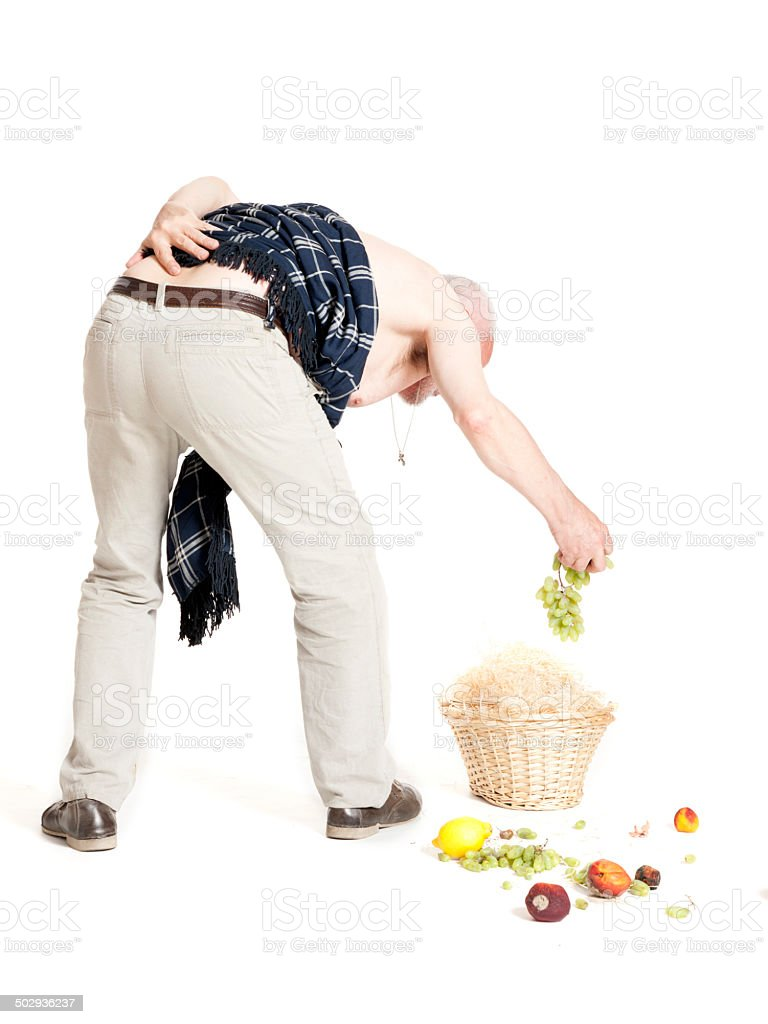 Man with back pain dropped fruit basket royalty-free stock photo
