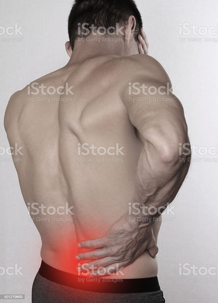 Man with back pain. Pain relief,  chiropractic concept stock photo