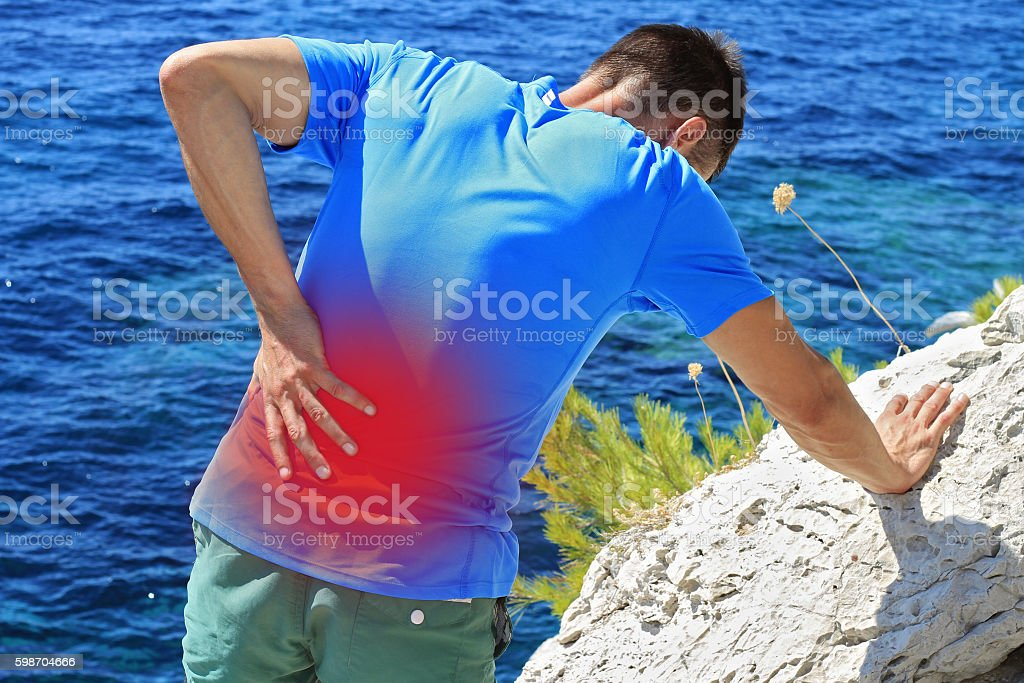 Man with back pain. Sport injury stock photo