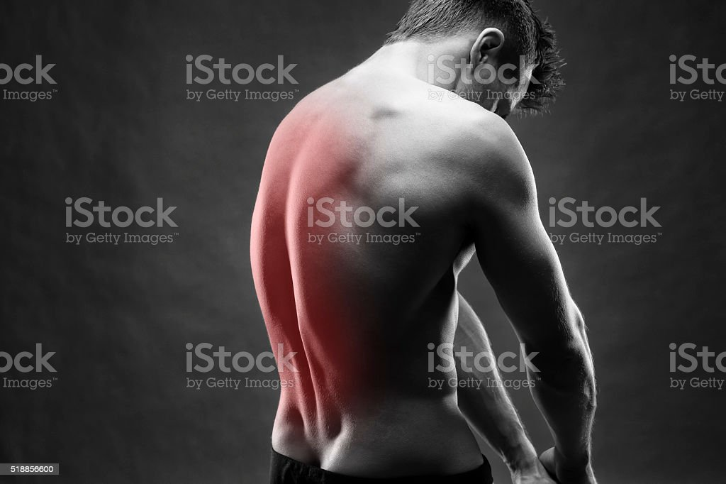 Man with backache on gray background stock photo