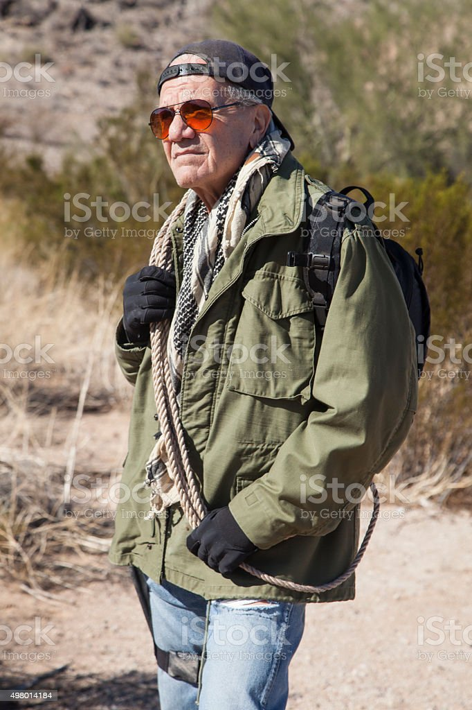 Man with backpack and survival gear. stock photo