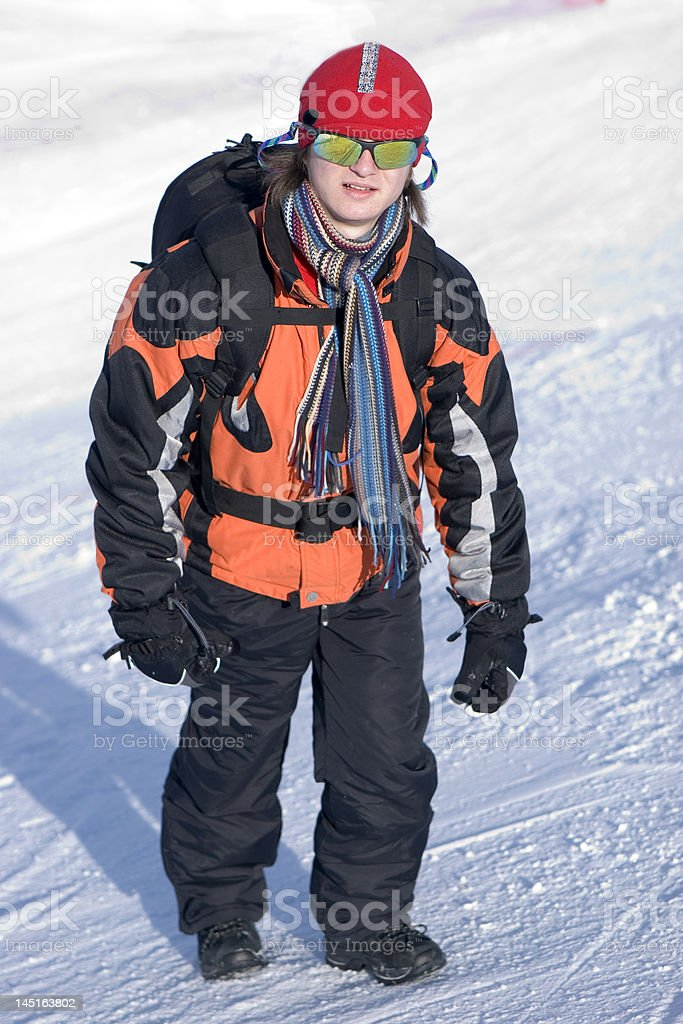 Man with Backpack in Winter Mountains on Snow royalty-free stock photo