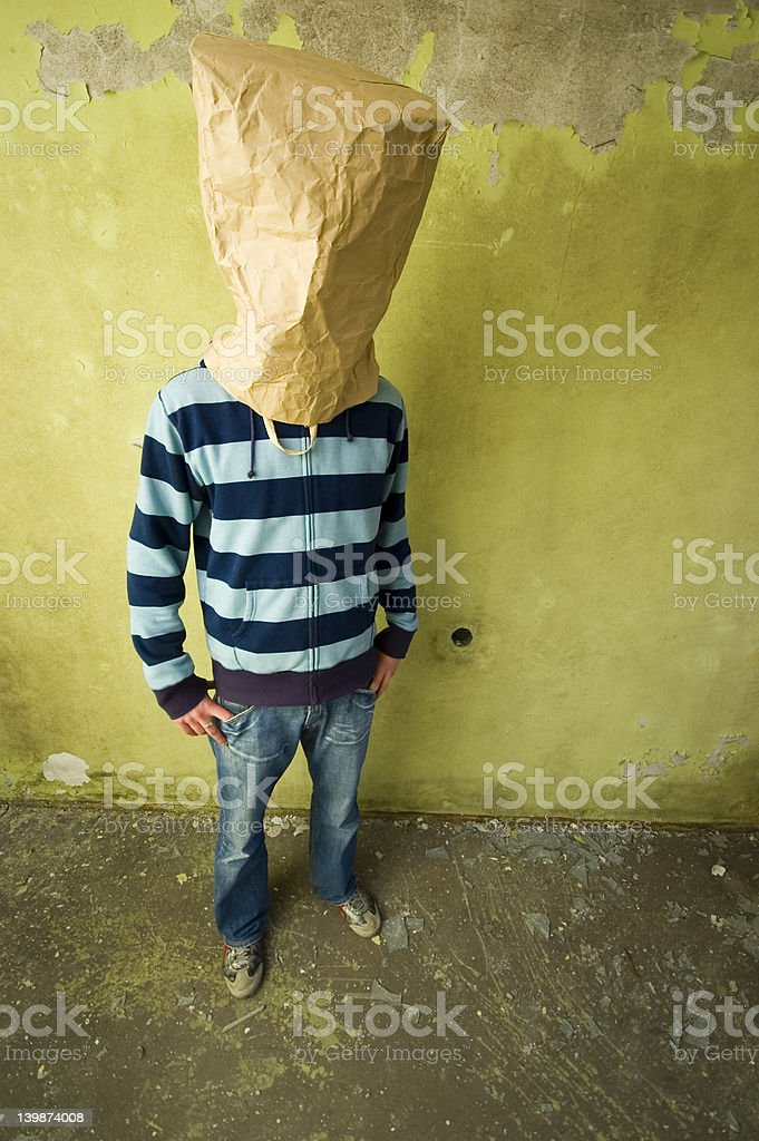 man with bag on head stock photo