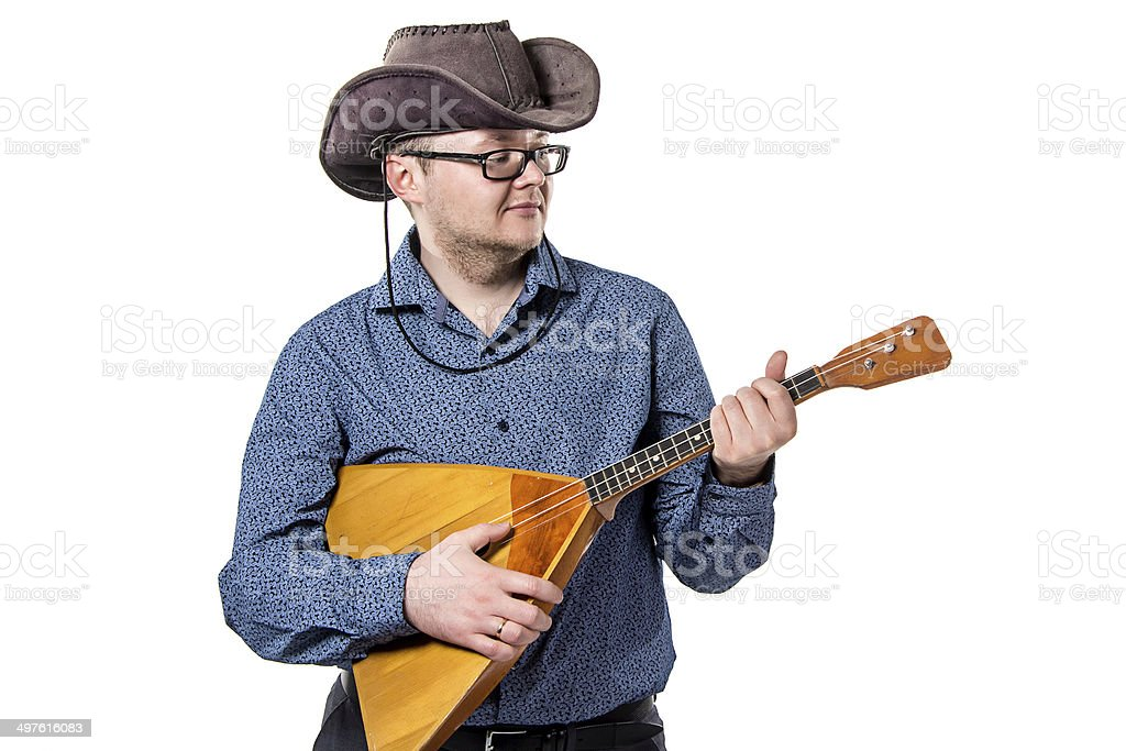 Man with balalaika in stetson stock photo