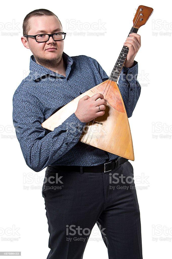 Man with balalaika playing stock photo