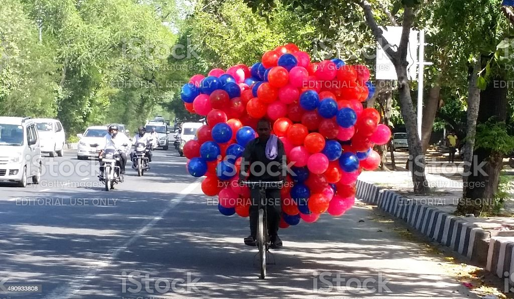 Man with Balloons on the main street stock photo