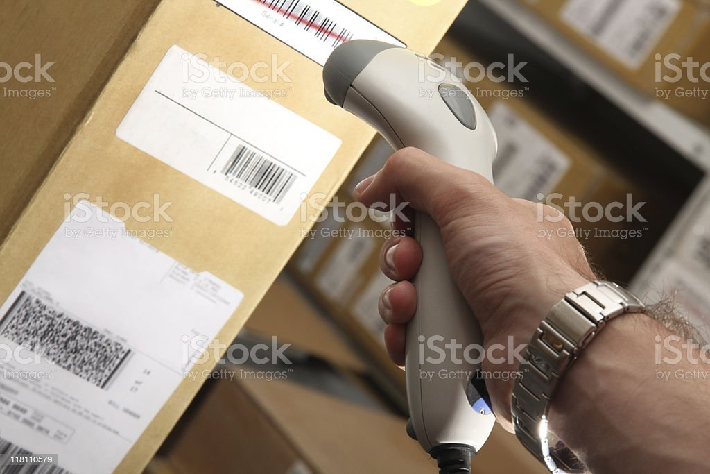 Man with barcode reader works on warehouse royalty-free stock photo